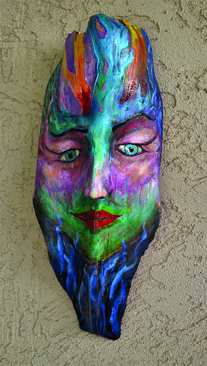 "**Elementa**  Through fire and ice, she must travel, through deep water, root and branch, leaf and blossom, earth and sky, to become herself.   She is the female counterpart to the mask entitled 'Elemental'  Mask size: 15"" high by 5"" wide"