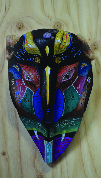 "**Jaguar Watches**  The spirit of the emerald forest watches, hidden amongst the jungle cover.   Mask size: 12 ½"" high by 8"" wide"